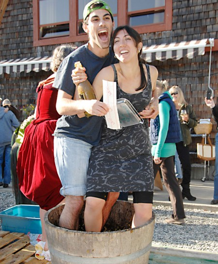 Visitors having fun at the Harvest Grape Stomp at Salt Spring Vineyards
